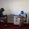 bob-signing-papers-at-the-immigration-office-at-lenakel-tanna