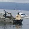 Chimere behind fishing boat and police launch at Liro